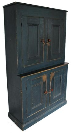 "19th century New England Stepback Cupboard in the original indigo blue paint, circa 1820, 18 1/4"" deep x 471/2"" wide x 77"" tall"