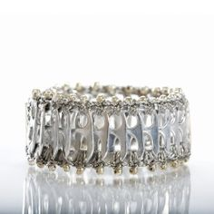 Pop top bracelet. Interesting recycling project!
