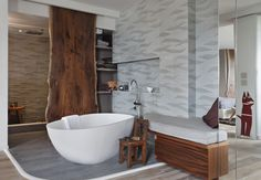 Artistic Tile | Designer Michele Rudolph, Riverside Design | One can truly be in touch with nature in this beautiful bathroom that features Ambra from the Hand-Carved collection.