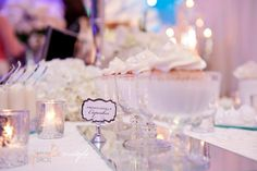Sparkle and White dessert buffet inspiration for the Winter Park Bridal Stroll by Two Sweets Bake Shop. www.lovetwosweets.com. Floral by Lee Forrest Design (www.leeforrestdesign.com), stationery by Dogwood Blossom Stationery (www.dogwoodblossomstationery.com), linens by Wildflower Linens (www.wildflowerlinens.com), photography by InStyle Imagery (http://www.instyleimagery.com/)