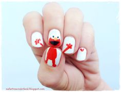 Sesame Street Elmo Nail Art  http://nailartinwonderland.blogspot.com.tr/2015/01/elmo-nail-art.html  Cookie Monster Nail Art