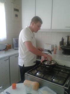 Baby boy making healthy lunch.