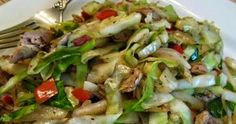2 tablespoons extra light olive oil 1 scallion 2 cloves garlic A pinch of red pepper flakes 1/2 medium cabbage (about 5 cups chop...