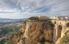 View of Parador of Ronda and its new bridge, Spain. View of Parador of Ronda and its new bridge, Spain. Andalusia Spain, Malaga Spain, Alhambra Spain, Narbonne France, Places To Travel, Places To See, Ronda Malaga, Spain Road Trip, Hill City