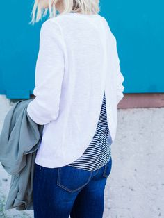 Spring '15 is all about layering. @damselindior  perfects her style with the Banana Republic Textured Cross-Back Pullover.