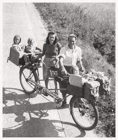 Lars Georg Swerin, a Swedish farm worker, takes his family on holiday on his modified tandem bike. He's pictured here with his wife Wiran and his four children all looking quite comfortable.