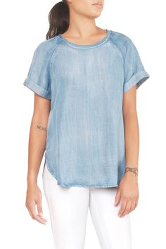Boxy fit top with rolled sleeves and round hem. In a faded blue color that looks like denim or chambray. It is actually super soft and flowy tencel! Great to wear with white jeans or khaki shorts.   Faded Blue Top by Laju. Clothing - Tops - Short Sleeve Oregon