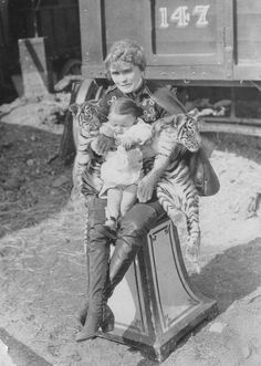 This is Mabel Stark when she worked one of the cage acts on the Ringling Show in the mid-1920's. No idea who the infant might be.
