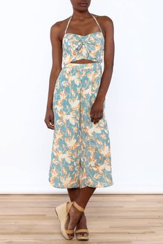 Printed jumpsuit with a sweetheart neckline, high waisted flared pant legs, midriff cut out and a back zipper closure.    Print Cut Out Jumpsuit by L'atiste. Clothing - Jumpsuits & Rompers - Jumpsuits Manhattan, New York City New York City