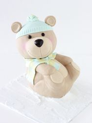 Here's an adorable teddy bear made by Sharon Wee (probably out of modeling chocolate.