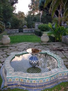 Fountain and pond with brightly colored tile....