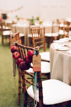inspiration | decorate the chairs at your sweetheart table with apple garlands | via: bridal guide