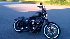 Iron 883 with Vance and Hines short shots, white walls, Z-bars and a dropped rear. Pretty sick.
