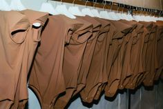 # Archive # Spring/Summer 2008.    Rack of flesh-colored bodysuits with enlarged shoulder lines, to be worn as a second skin