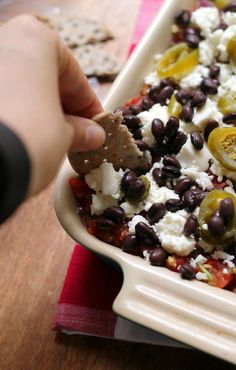 Mexican 5-layer bean dip with layers of refried beans, fresh tomato salsa, black beans, spicy pickled jalapenos, and crumbled queso fresco makes for the perfect appetizer!