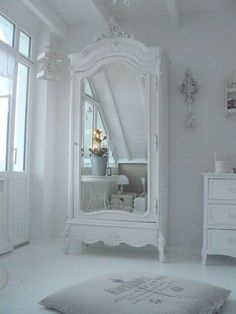 French White Bedroom with Armoire and Bird Cage