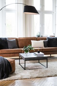 """This is how the look """"Black & Brown"""" works: Trendy yet timeless – a leather couch in cognac brown is super hip and leaves the style of the Se … - ALL ABOUT Living Room Sofa, Living Room Interior, Living Room Decor, Home Interior, Apartment Living, Design Tisch, Decoration Inspiration, Color Inspiration, Brown Sofa"""