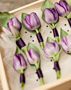 I like these. I like the purple ribbon around them but probably only in a lighter purple color. They are pretty and simple with not to much purple.