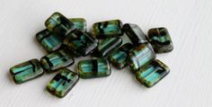 26 CENTS PER BEAD ~~  8x12mm      $3.95 FOR 15 Aqua Tortoise Picasso   Czech Glass Rectangle Table Top Beads