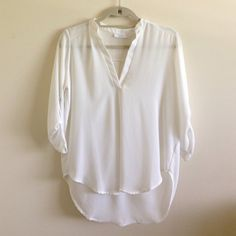 BP NORDSTROM SILK/SHEER 3/4 SLEEVE WHITE TOP BP NORDSTROM SILK/SHEER 3/4 SLEEVE WHITE TOP IN SIZE SMALL. This is a beautiful top that's in excellent condition but needs to go because I never wear it. The back dips down a little longer than the front and this can pass as a casual/formal top. It is a little transparent but looks very cute when worn with a bralette! Always accepting offers - no trades!! Nordstrom B&P Tops Blouses