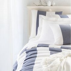 Let your preppy side shine with this cotton duvet cover featuring classic, broad stripes of contrasting indigo and white. Create a sleek nautical look by layering in tailored white sheets and pillows, or go fresh and fun with brights like fuchsia and citrus. • 100% cotton. • Vertical stripes. • Knife edge. • Hidden button closure.