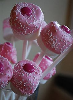 Marsh mallows dipped in pink-colored white chocolate topped with a pink M&M - yum!