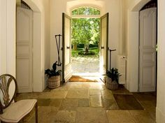 I would love a house with an entryway.  Love the stone floor, too!