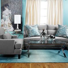 I know you're thinking HOLY TURQUOISE Batman! But I like the grays with the throw pillows ... always thinking!