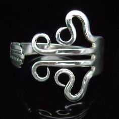 Recycled Fork Bracelet, Eco Friendly Silverware Jewelry in Curly Design Number Three. $29.99, via Etsy.