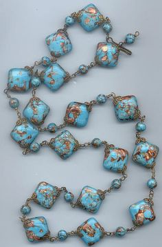 long necklace of vintage Venetian lampwork glass beads - turquoise with coppery aventurine
