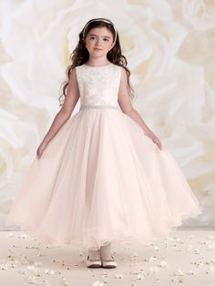 Sleeveless satin, tulle and lace tea-length A-line dress with hand-beaded jewel neckline, lace appliqué over satin bodice features beaded waistband and back covered buttons, full gathered multi-layer tulle skirt finished with wire scalloped edges, suitable for both First Communion and flower girls.Sizes: 2 – 14