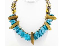 With gold pendant and turquoise stone accents, this collar necklace is a royal accessory and easily made DIY statement necklace for fall.