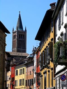 view of one street of Parma, with the dome tower in background, Italy