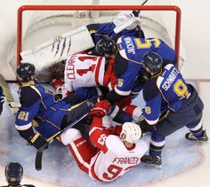 "Pileup in the crease: Hockey's version of ""How many people will fit into a phone booth?"""