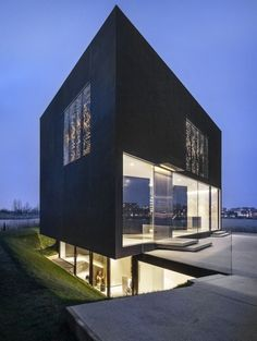 Studioninedots have designed a home on an island near Amsterdam, The Netherlands.
