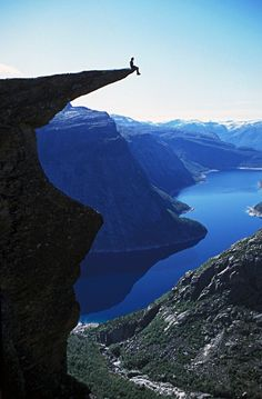 Solitude atop a cliff in Norway.This guy is just nuts