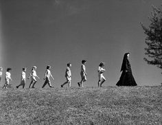 """Children from Guardian Angel Catholic School, led by a nun in 1968.  Photographers note: """"Going camping"""""""