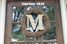 This is the wreath I made for my front door for fall.  M from Hobby Lobby - $2, Wreath - $3.50 - Walmart, Twine - to wrap letter - $4 - Walmart.  Total - $9.50 - love it! lovethedawgs