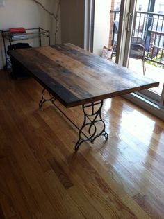 Reclaimed Wood Table Top with sewing machine table legs!