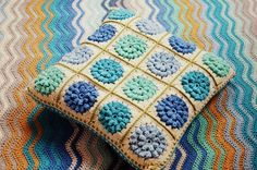 Beautiful granny square cushion! With links to pattern and other techniques used.