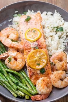 Delicious one pan salmon recipe with shrimp and asparagus. Easy oven baked salmon recipe seasoned and cooked to perfection. Delicious one pan salmon recipe with shrimp and asparagus. Easy oven baked salmon recipe seasoned and cooked to perfection. Oven Baked Salmon, Baked Salmon Recipes, Seafood Recipes, Cooking Recipes, Baked Shrimp, Baking Salmon In Oven, Dinner Recipes, Crockpot Recipes, Dinner Ideas