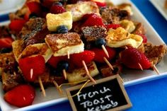 French Toast kebabs. Layer french toast and berries and finish with a dusting of powdered sugar.