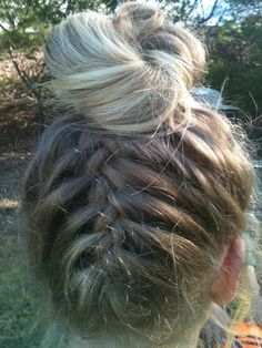 Super easy to do!  All you have to do is flip your hair over, and French Braid upside down. Start at the bottom and work your way up. Stop where you want your bun to be then, gather it all together and grab a ponytail holder.