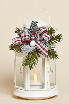 "8""H White Lantern with Removable Holiday Decor Featuring Frosted Greens, a Red, Grey and White Plaid Bow and Battery Tea Light"