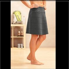 Athleta Strata Skirt Soft, comfortable, wrinkle-resistant knit fabric makes this skirt into a travel essential that looks great the minute you pop it out of your suitcase. Charcoal gray. Athleta Skirts