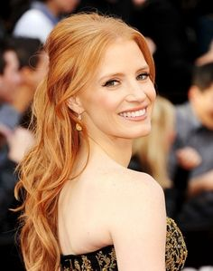 Jessica Chastain at the 2012 Oscar's Academy Awards show. Her hair has the perfect blend of color and volume. I love this half up half down hairstyle. It has Oscar's written all over it. Jessica Chastain is nominated for the 2012 Academy Awards Best Actress in a Supporting Role.