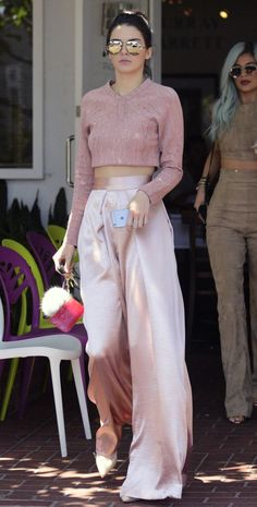 Rose Quartz Palette: Kendall Jenner in pale pink wide leg silk pants and pale pink cropped top