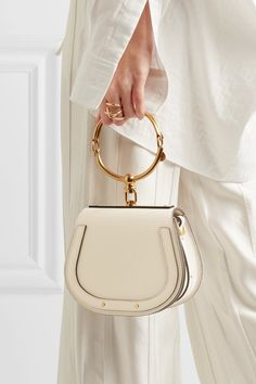 Ivory leather and suede (Calf) Snap-fastening front flap Comes with dust bag Weighs approximately 2.6lbs/ 1.2kg Made in ItalyAs seen in The EDIT magazine