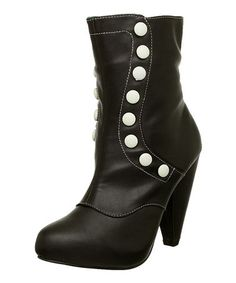 Take a look at this Black & White Button Boot by T.U.K. on #zulily today!