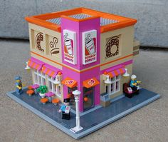 Suzi More's Dunkin Donuts, with its custom stickers and bright colours, looks like the real thingand good enough to eat. OK, maybe not the whole building, but the donuts definitelyare. The…